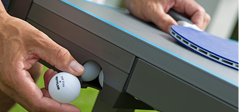 Figure: Praktická možnost uskladnění míčků a pálek