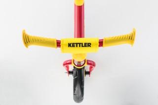 Balance bike handlebar with safety handles and handlebar padding